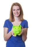 Young woman with red hair and piggy bank Stock Photo