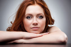 Young woman with red hair portrait stock photos
