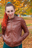 Young woman with red hair portriat. Beautiful girl with braids w Royalty Free Stock Images