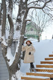 Young woman with red hair in a sheepskin coat. winter background Royalty Free Stock Photography