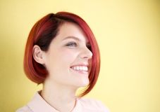 Young woman with red hair smiling Stock Images