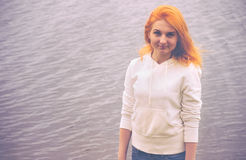 Young Woman with red hair walking outdoor Lifestyle. Concept sea on background film effects colors Stock Photos