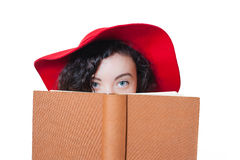 Young woman with red hat blue eyes and brown book Royalty Free Stock Photography