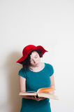 Young woman with red hat reading book Royalty Free Stock Photo