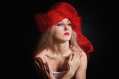 Young woman in a red headdress Stock Photo