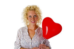 Young woman with red heart ballon Royalty Free Stock Images