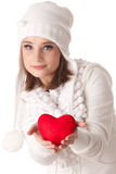 Young woman with red heart in hands. The beautiful young woman holds in hands a red heart on a white background. Selective focus on heart Stock Photography