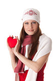 Young woman with red heart in hands Royalty Free Stock Image