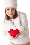 Young woman with red heart in hands Royalty Free Stock Photos
