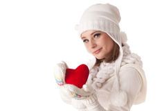 Young woman with red heart in hands. The beautiful young woman holds in hands a red heart on a white background. Selective focus on heart Royalty Free Stock Photo