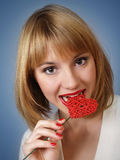 Young woman with red heart in hands Royalty Free Stock Photo