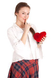 Young woman with red heart keeping silence Stock Photo