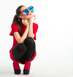 Young woman in red with heart shaped glasses Stock Photography