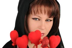 Young woman with red hearts Stock Photography