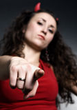 Young woman with red horns pointing Royalty Free Stock Photography