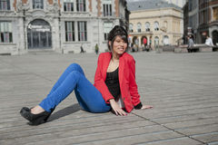 Young woman in red jacket Royalty Free Stock Image