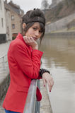 Young woman in red jacket looking depressed Royalty Free Stock Photos