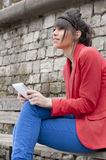 Young woman in red jacket with tablet Stock Image