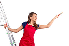 Young woman in a red jumpsuit on  ladder Royalty Free Stock Images