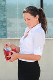 Young woman with red leather wallet Stock Photography