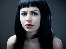 Young vampire with red lips. Stock Photo