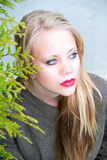 Young woman with red lips. Which looks into the distance Royalty Free Stock Photography