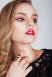 Young Woman with Red Lips Looking Away. Young Female with Red Lips Looking Away Stock Images