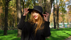 Young woman with red lips in stylish coat and hat Stock Photography