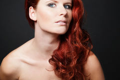 Young  woman with red long hair. Royalty Free Stock Photos