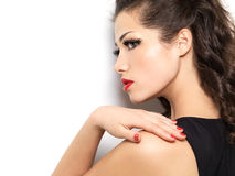 Young woman with red manicure and lips Royalty Free Stock Photography