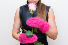 young woman in red mittens holds rose Royalty Free Stock Photography