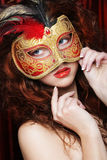 Young woman in a red mysterious  mask Stock Photos
