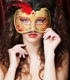 Young woman in a red mysterious  mask Royalty Free Stock Photos