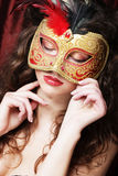 Young woman in a red mysterious  mask Stock Photography