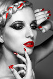 Young woman with red nails Stock Images