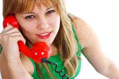 Young woman with red old-fashioned telephone Royalty Free Stock Image