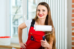 Woman renovating her apartment Stock Photo