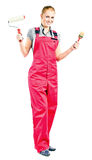 Young woman in red overalls with painting tools Stock Photos