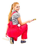 Young woman in red overalls with painting tools Royalty Free Stock Images