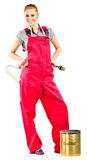 Young woman in red overalls with painting tools Royalty Free Stock Photos