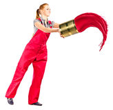 Young woman in red overalls with red paint. Isolated on white stock photography