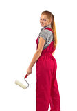 Young woman in red overalls on white royalty free stock image