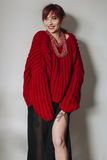 Young woman in red oversized sweater and black skirt Stock Photography