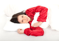 Young woman in red pajamas Stock Images