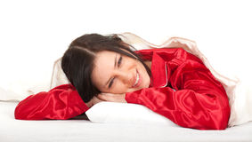 Young woman in red pajamas Royalty Free Stock Photography
