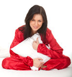 Young woman in red pajamas Stock Photos