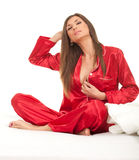 Young woman in red pajamas Stock Photography
