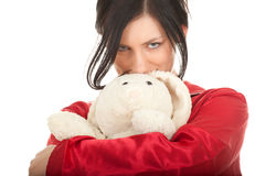 Young woman in red pajamas with teddy bear Stock Photo