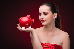 The young woman with red piggybank Royalty Free Stock Photo