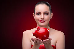 The young woman with red piggybank Royalty Free Stock Photos